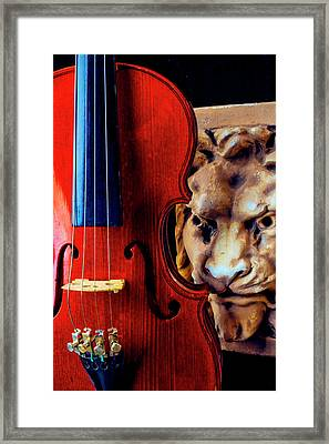 Lion And Violin Framed Print