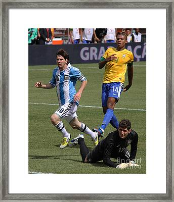 Lionel Messi Beats Rafael Cabral Framed Print by Lee Dos Santos
