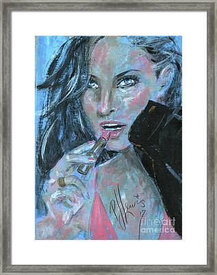 Lipstick And Leather Framed Print by P J Lewis
