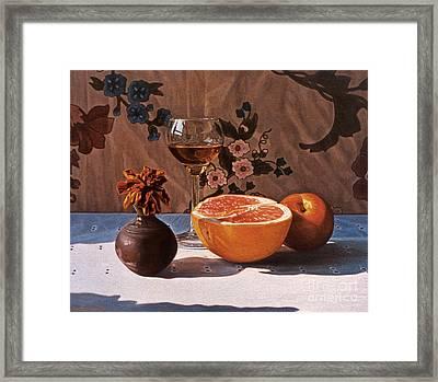 Liqueur Glass And Grapefruit Framed Print by Daniel Montoya