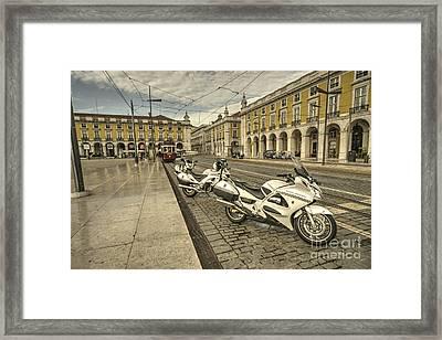 Lisbon Police Bikes  Framed Print by Rob Hawkins