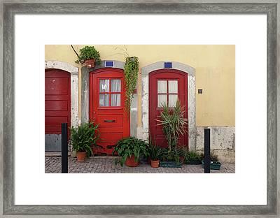 Lisbon Red Doors Framed Print