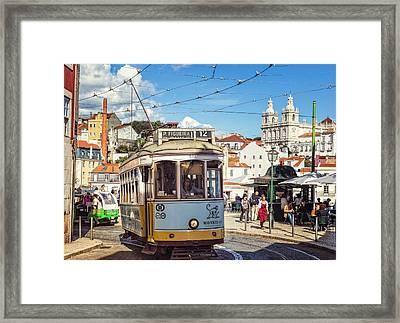 Lisbon Tram Framed Print by Joan Carroll