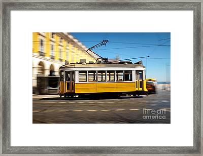 Lisbon Tram Panning Framed Print by Carlos Caetano