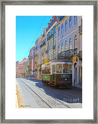 Lisbon Trams Framed Print by Carey Chen