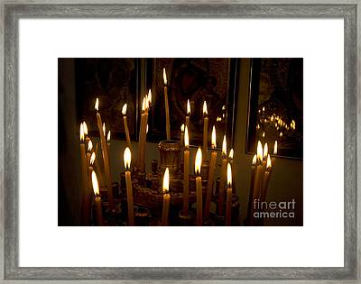lit Candles in church  Framed Print by Danny Yanai