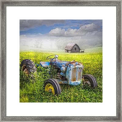 Little Blue Tractor Framed Print by Debra and Dave Vanderlaan