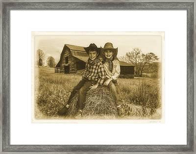 Little Cowboys Framed Print by Debra and Dave Vanderlaan