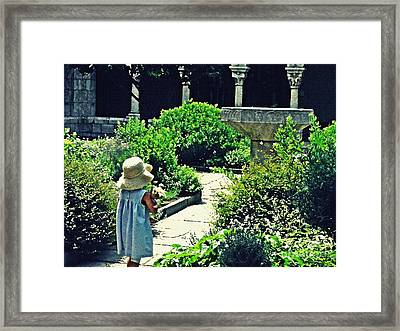 Little Girl At The Cloisters Framed Print by Sarah Loft