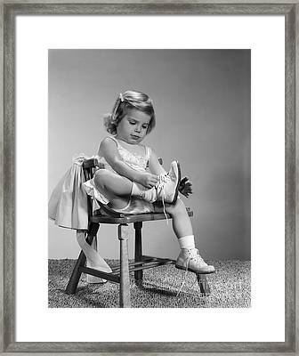 Little Girl Putting On Shoes, C.1960s Framed Print by H. Armstrong Roberts/ClassicStock