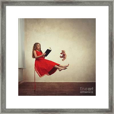 Little Girl Reading To Her Teddy Bear Framed Print