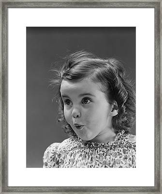Little Girl With Surprised Expression Framed Print
