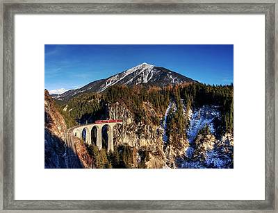 Framed Print featuring the photograph Little Red Train In The Swiss Alps by Peter Thoeny