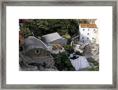 Living On The Cliffside Framed Print by Morris Keyonzo