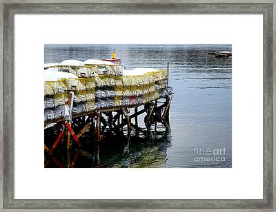Lobster Traps In Winter Framed Print by Olivier Le Queinec