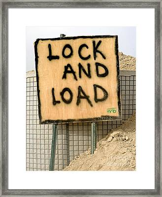 Lock And Load Framed Print by Unknown