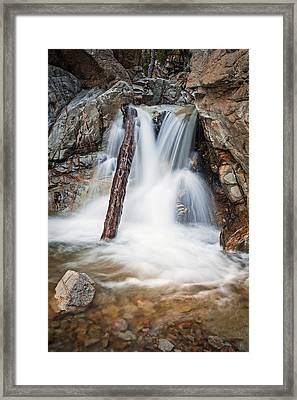 Log In The Waterfall Framed Print