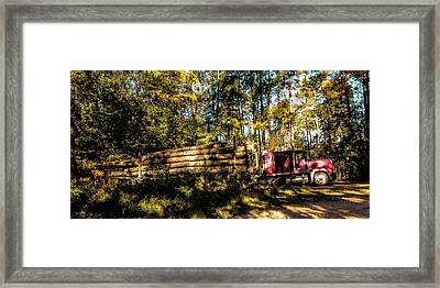 Log Truck Framed Print by Leon Hollins III
