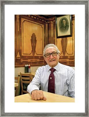 London Cafe Owner Framed Print by Brian Benson