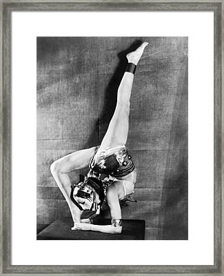 London Dancer Wearing A Mask Framed Print by Underwood Archives