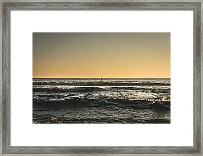 Lone Paddler At Sunset Framed Print by Marco Oliveira