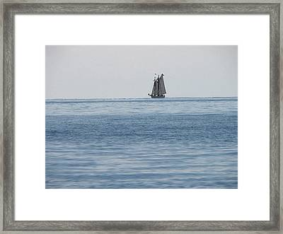 Lone Ship At Sea Framed Print by Ginger Howland