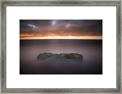Framed Print featuring the photograph Lone Stone At Sunrise by Adam Romanowicz