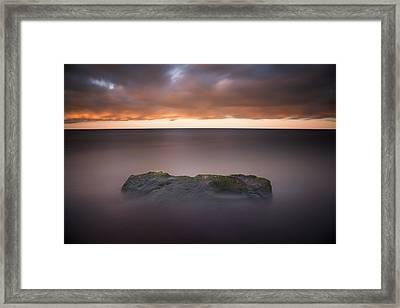 Lone Stone At Sunrise Framed Print by Adam Romanowicz