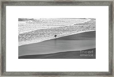 Framed Print featuring the photograph Lone Surfer by Nicholas Burningham
