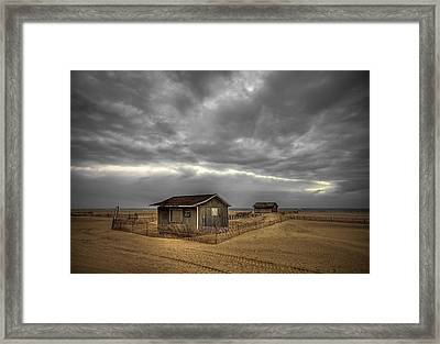 Lonely Beach Shacks Framed Print by Evelina Kremsdorf