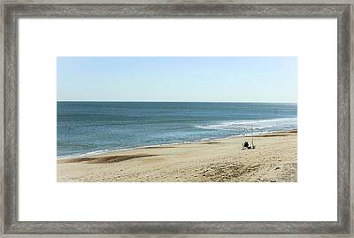 Lonely Chair On The Beach Framed Print