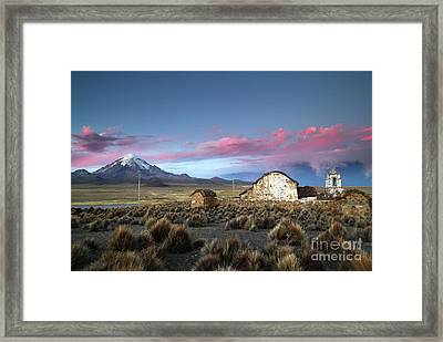 Lonely Church Sajama Volcano And Stormy Altiplano Skies Bolivia Framed Print