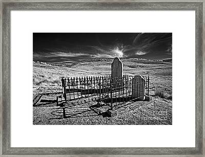 Lonely Graves Framed Print by Russ Brown