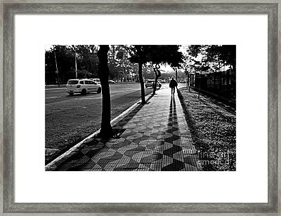 Lonely Man Walking At Dusk In Sao Paulo Framed Print