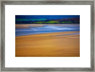 Lonesome Man Walking On Sand Beach Framed Print by Panoramic Images