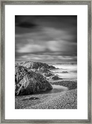 Long Exposure Of A Shingle Beach And Rocks Framed Print