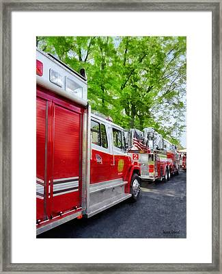 Long Line Of Fire Trucks Framed Print by Susan Savad