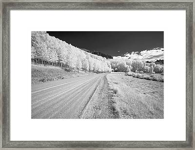 Framed Print featuring the photograph Long Road In Colorado by Jon Glaser