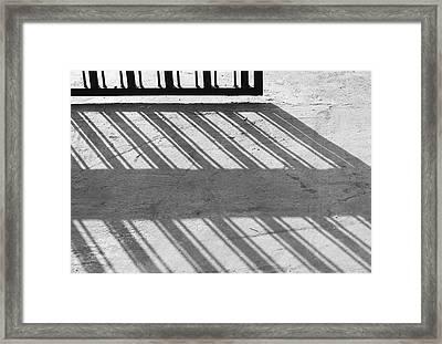 Long Shadow Of Metal Gate Framed Print by Prakash Ghai