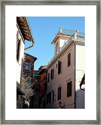 Look Up To The Rooftops In Panicale Framed Print