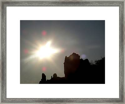 Looking At The Sun  Framed Print by Lyle Crump