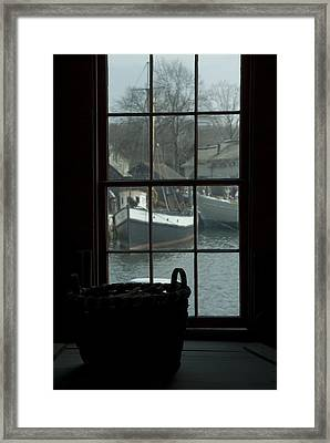 Looking Out Through A Window At Wooden Framed Print by Todd Gipstein