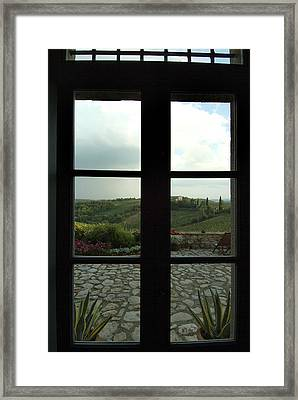 Looking Through A Window To The Rolling Framed Print by Todd Gipstein