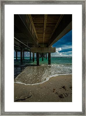 Looking Under The Pier Framed Print
