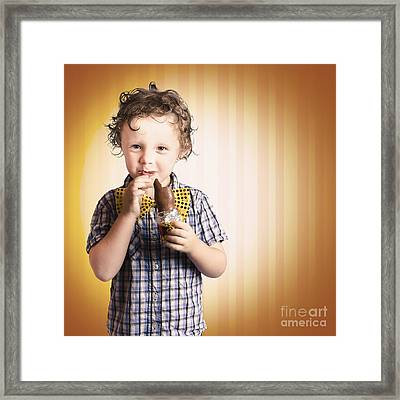 Lovable Little Child Eating Chocolate Easter Bunny Framed Print by Jorgo Photography - Wall Art Gallery