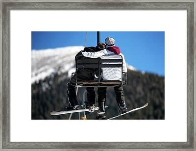 Lovers On Ski Lift Framed Print by Susan Schmitz