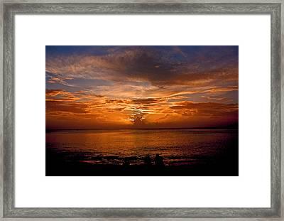 Lovers Sunset Framed Print by Martin Morehead
