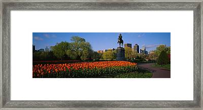 Low Angle View Of A Statue In A Garden Framed Print