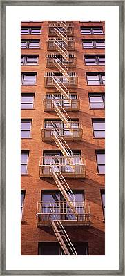 Low Angle View Of Fire Escape Ladders Framed Print