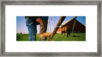 Low Section View Of A Cowboy Adjusting Framed Print by Panoramic Images